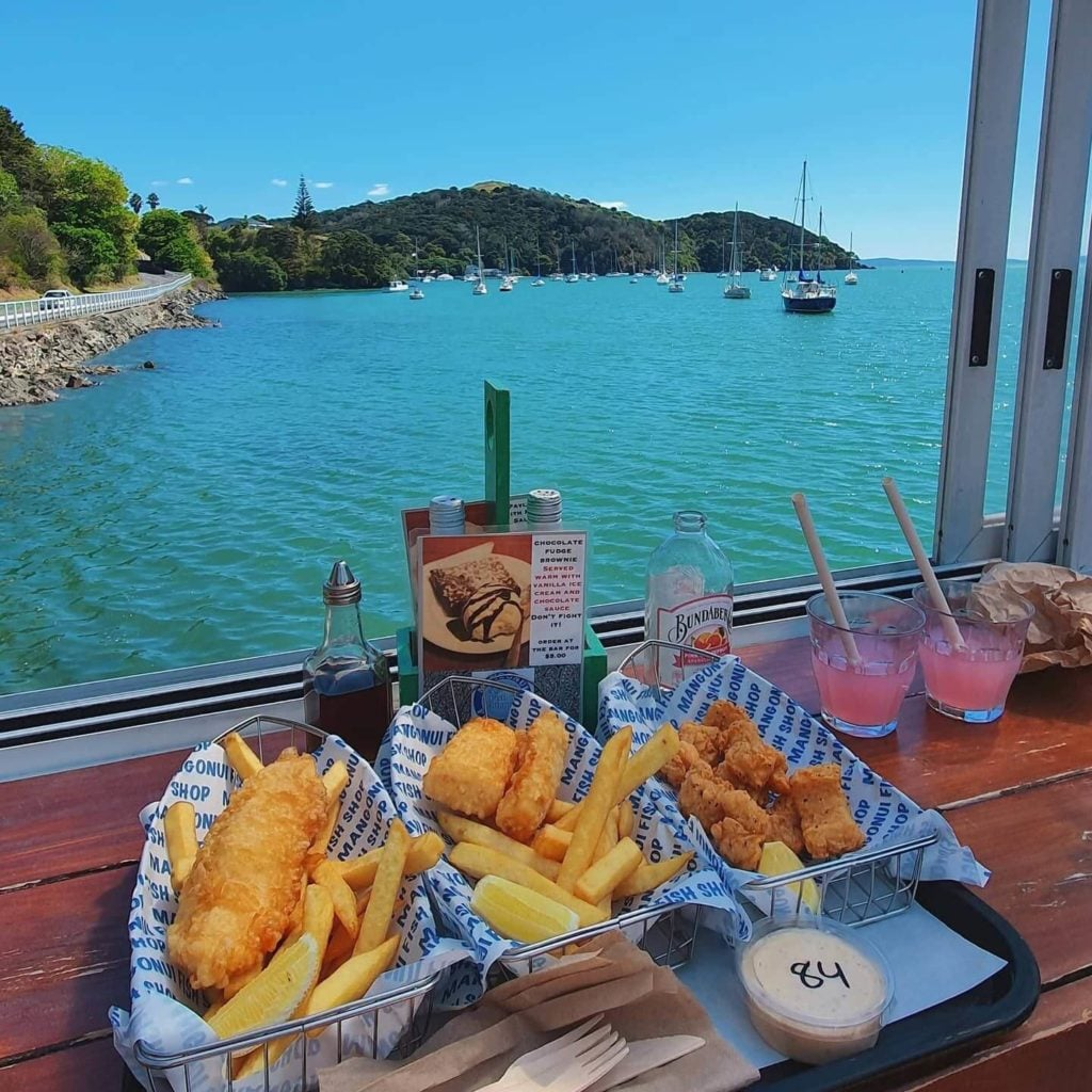 fish and chips overlooking blue water Mangonui town New Zealand