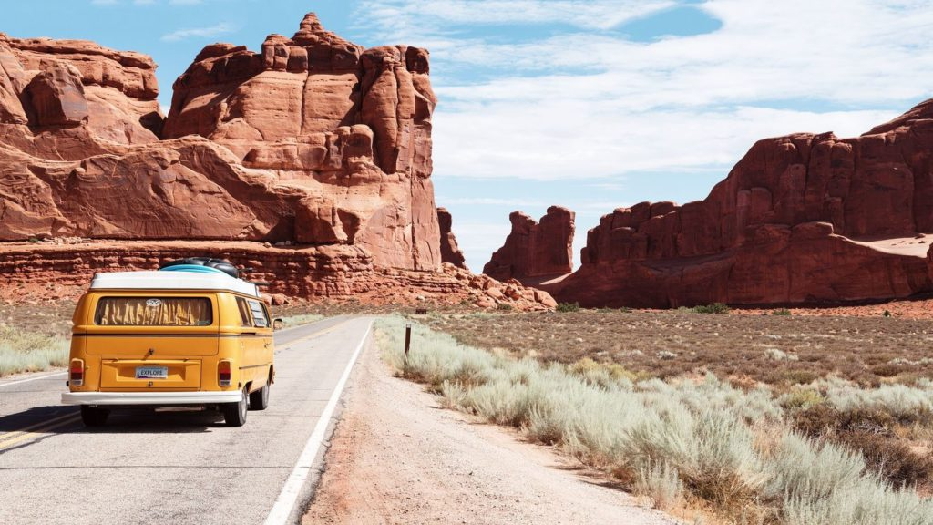 yellow van driving through Arches National Park