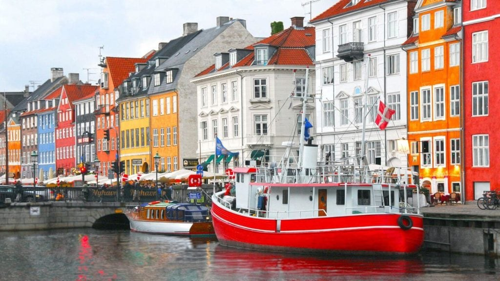 colourful houses lining the canals of Copenhagen Denmark