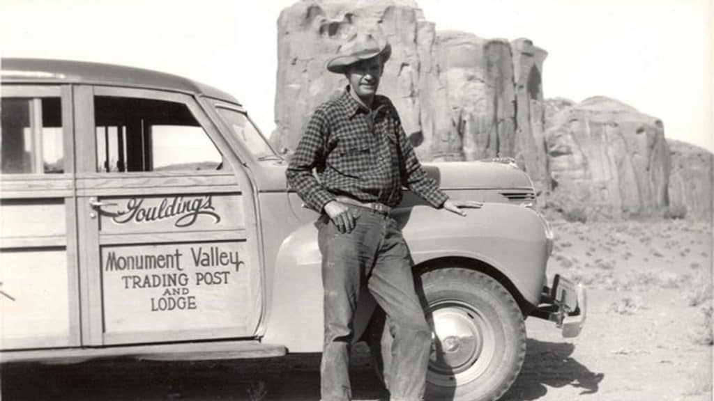 Harry Goulding standing with his car in Monument Valley