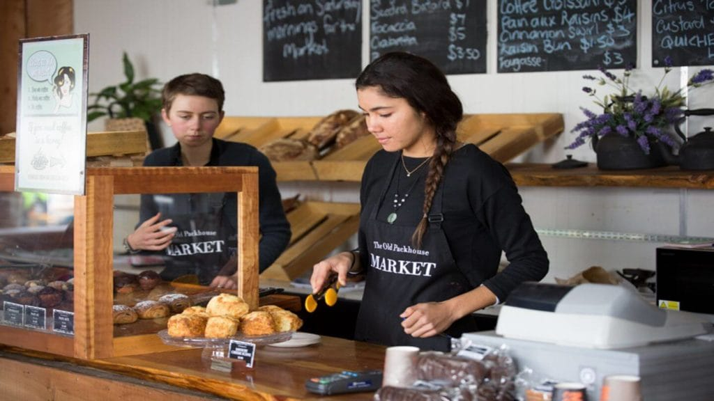 two people working at a bakery in the Old Packhouse Market New Zealand
