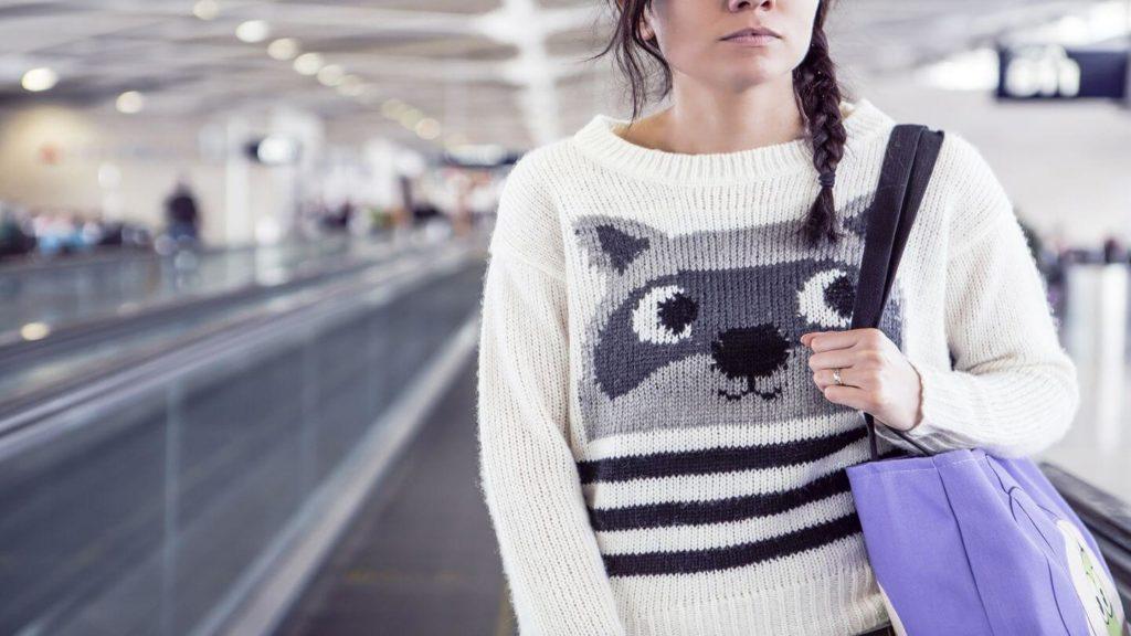 woman wearing warm jumper in airport