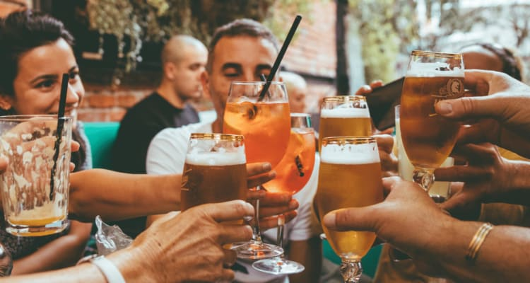 A group of people enjoying cocktails and beer