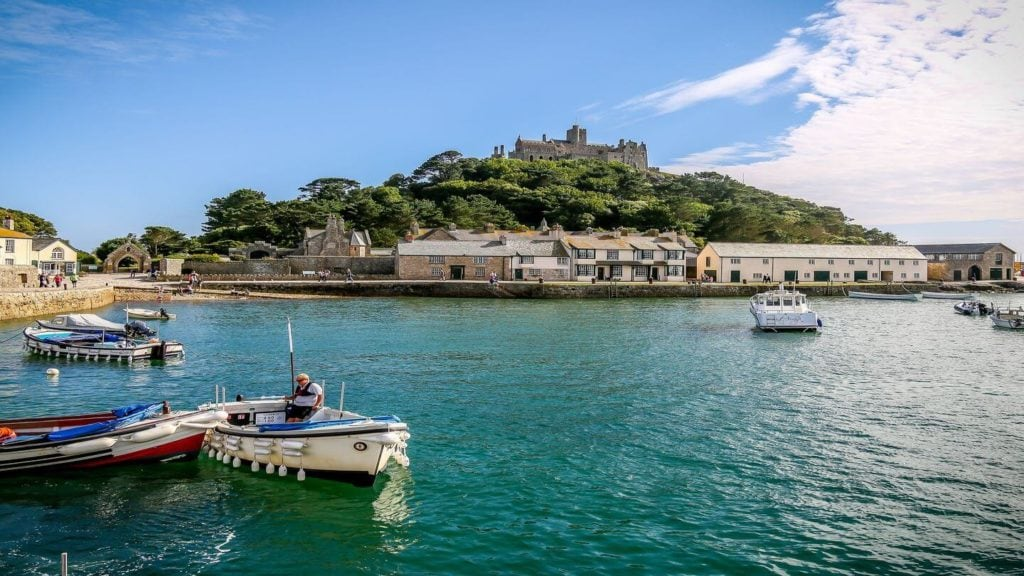 st michaels mount surrounded by blue water and boats St Ives England
