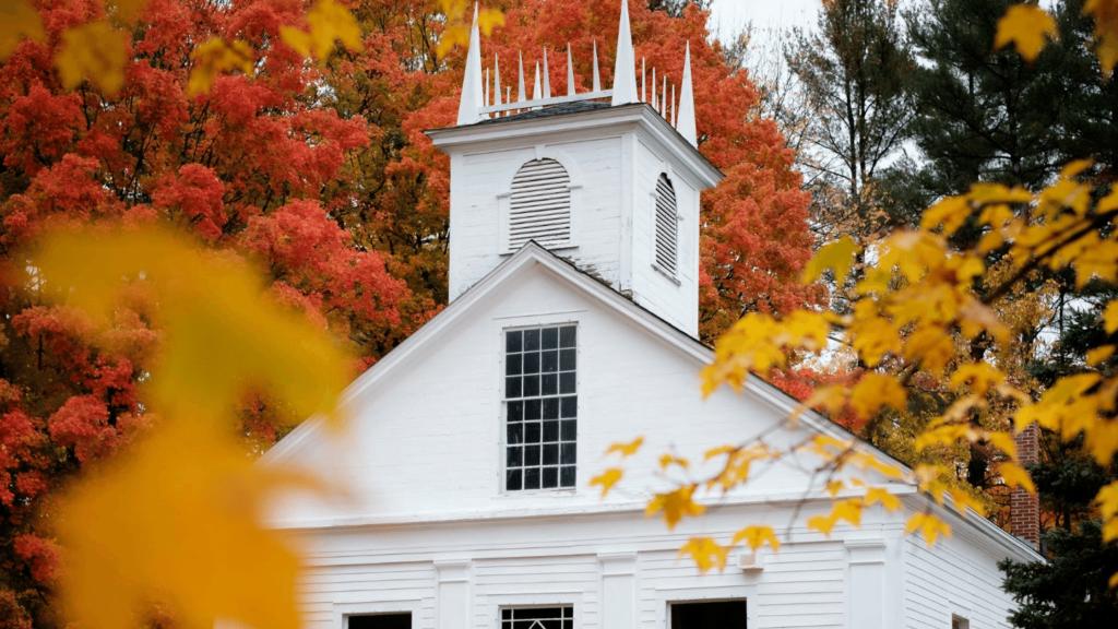 Fall foliage on white church New England