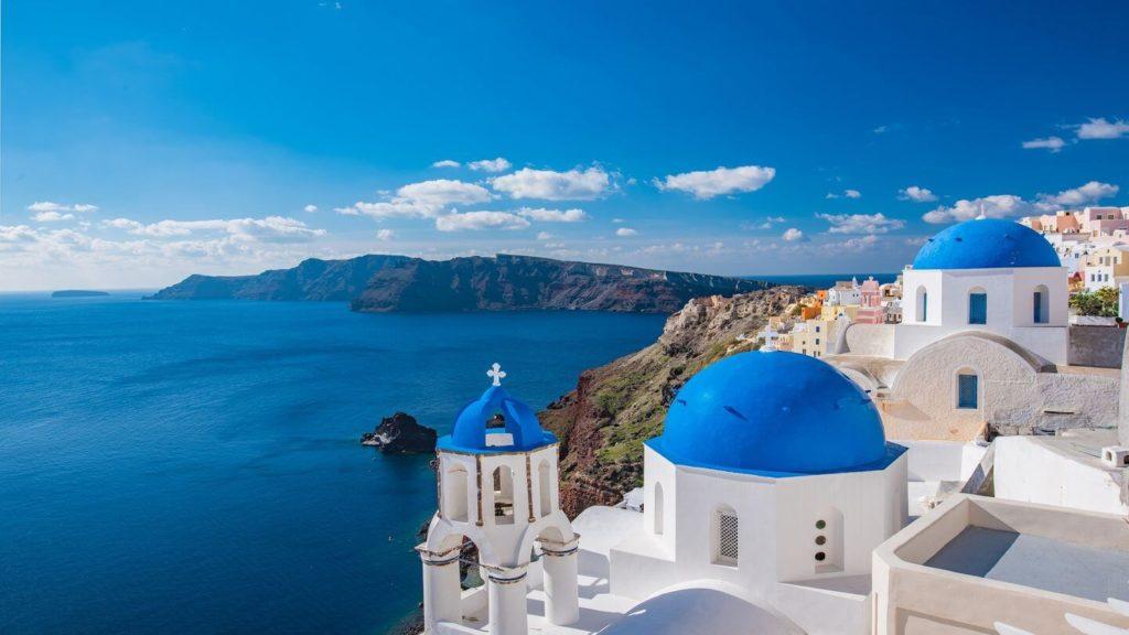 blue domes whitewashed buildings Santorini Greece