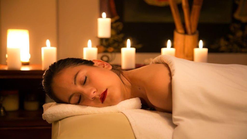 woman getting candle lit hotel massage