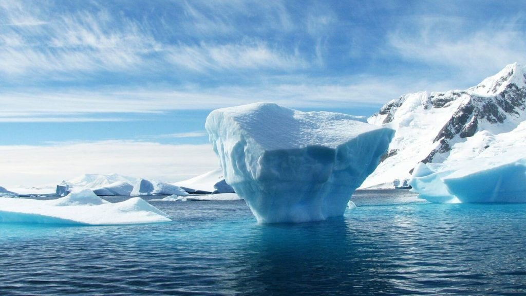 glowing blue iceberg Antarctica celebrate retirement
