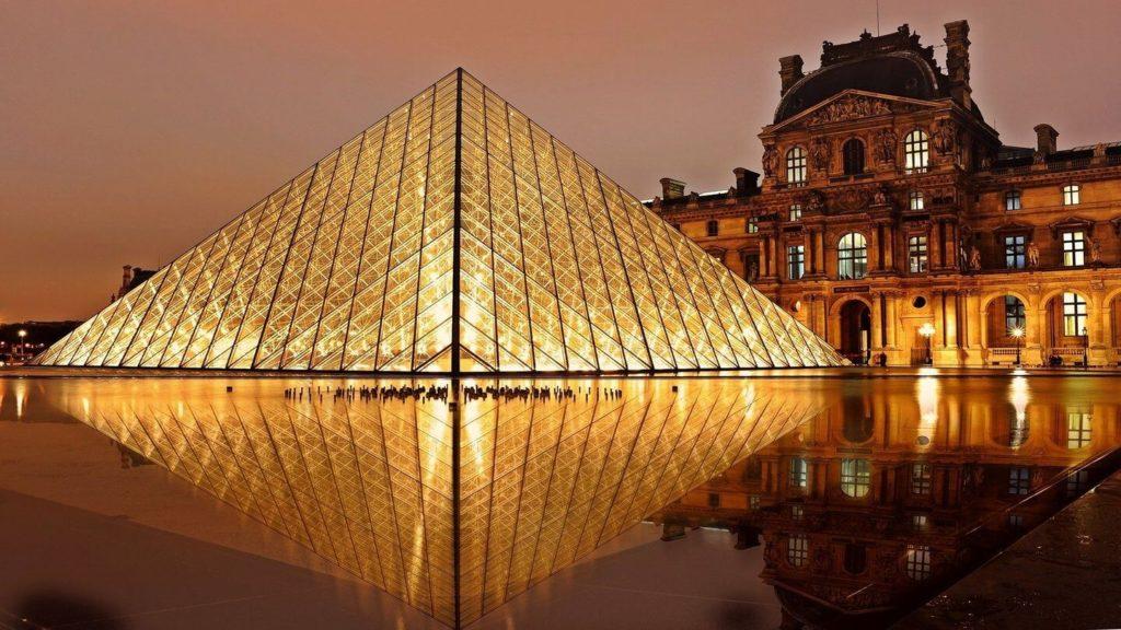 The Louvre pyramid illuminated at night