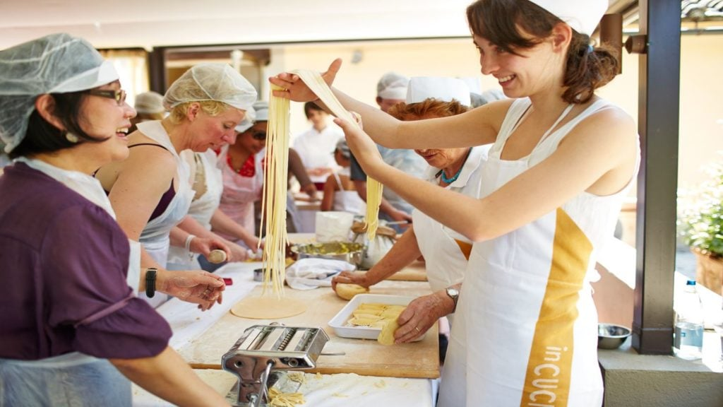 Trafalgar guest learning to making pasta in Italy