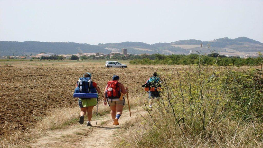 pilgrims walking the Camino de Santiago with backpacks