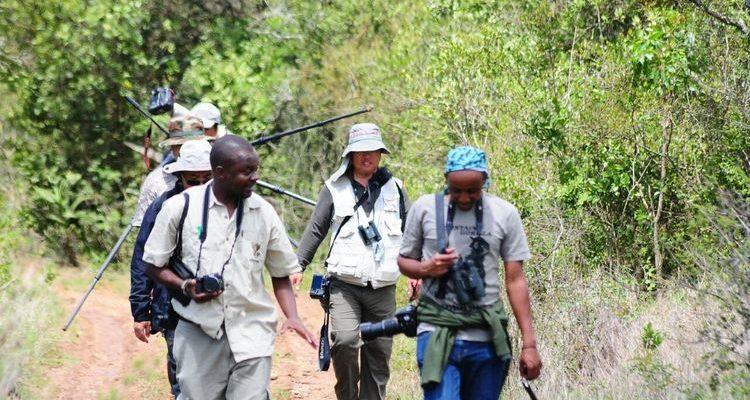 Dedan with guests on safari in Kenya