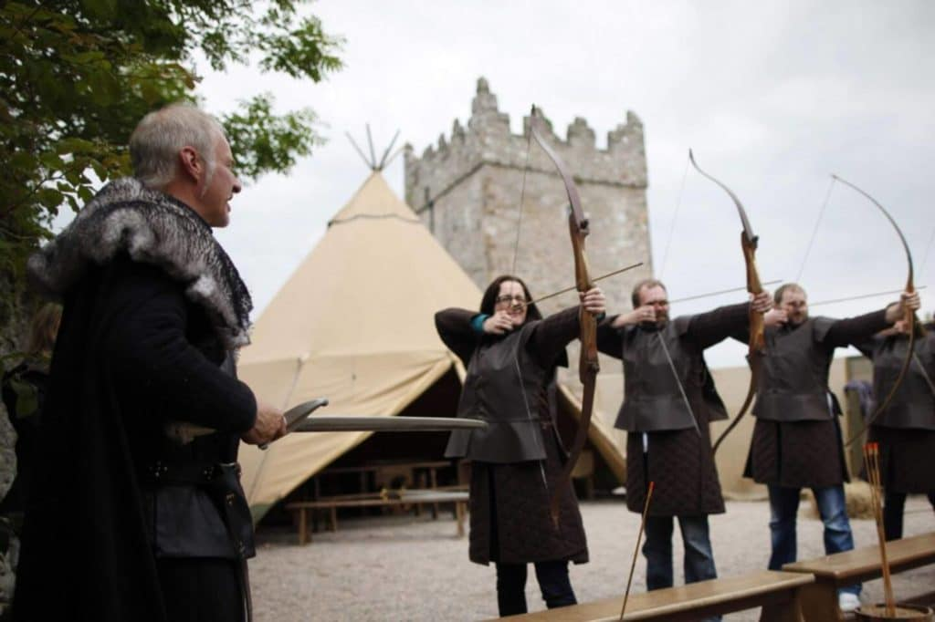 adults practicing archery at the Winterfell movie set range large family holidays