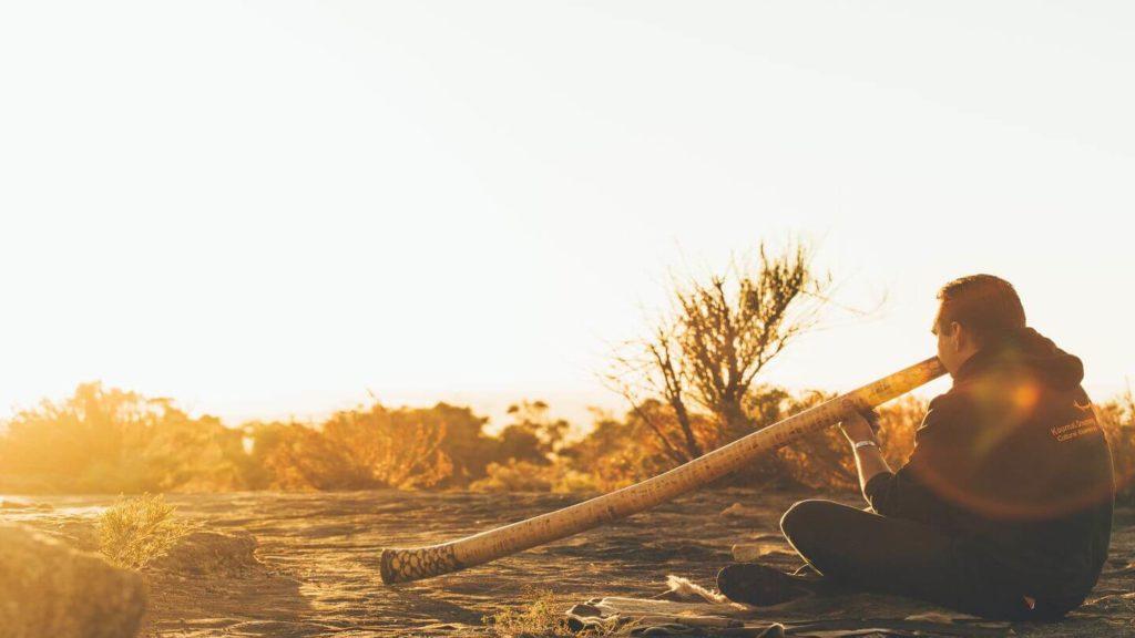 Indigenous man playing the didgeridoo Australia