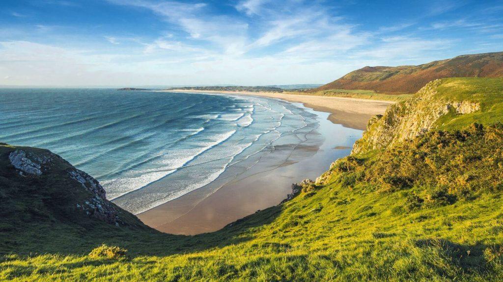 green hills blue ocean coast of England