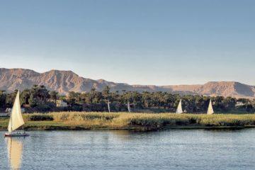 sail boats cruising the Nile river Egypt