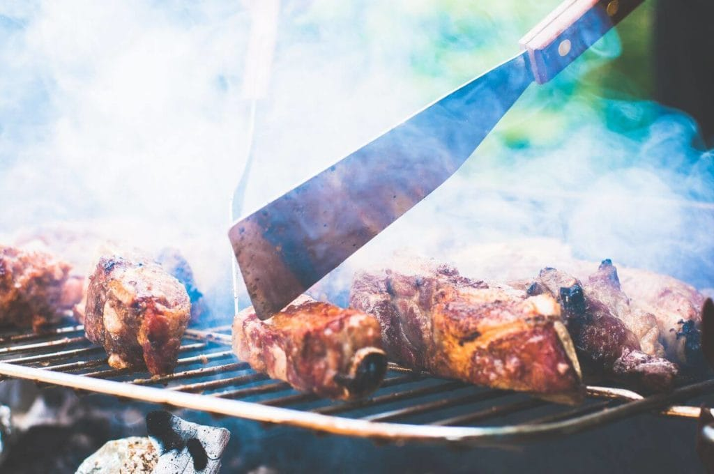 meat on a smoky grill South African braai
