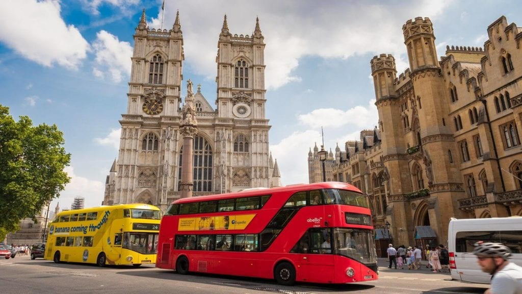 iconic red bus old buildings London
