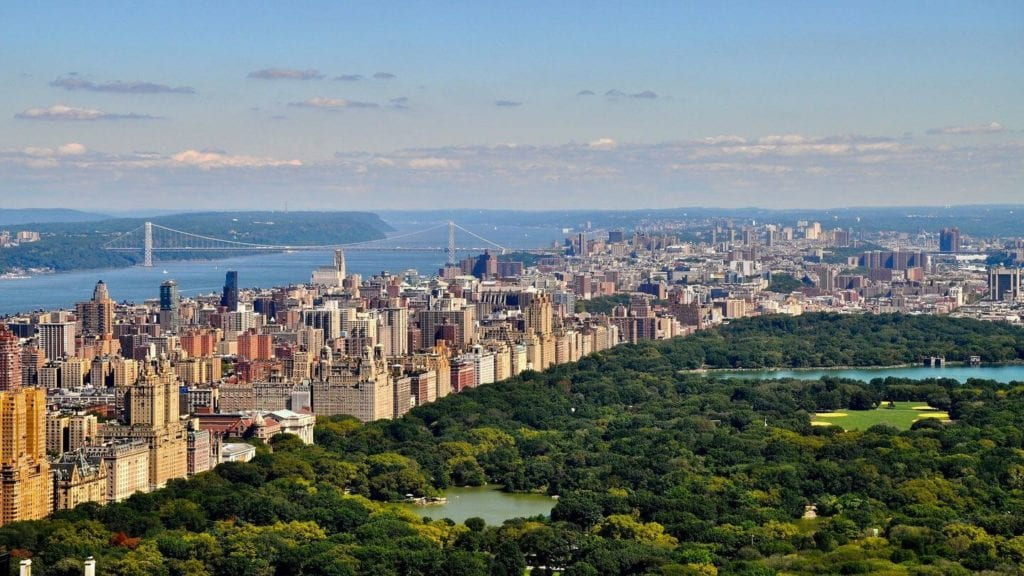 aerial view over Central Park, Brooklyn Bridge and Manhattan New York