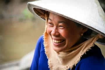 Vietnamese woman smiling importance of tourism
