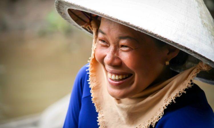 Vietnamese woman smiling importance of tourism
