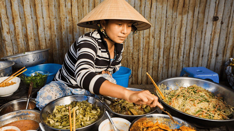 Vietnamese street food served by Vietnamese woman