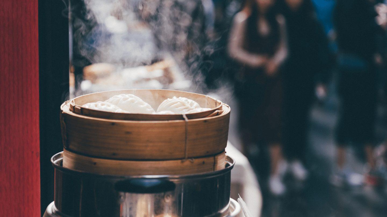 basket of steaming Chinese dumplings