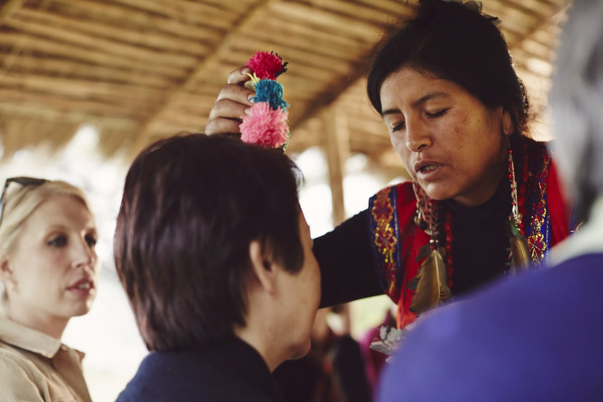 A local Peruvian woman blessing a guest