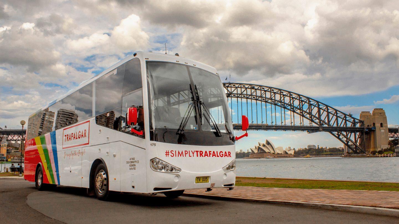 Trafalgar coach in front of Sydney Harbour Bridge