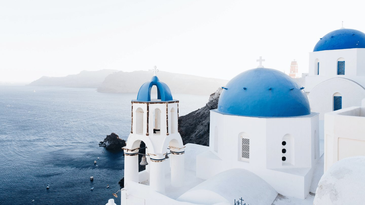restart travel deal - blue domes of Santorini