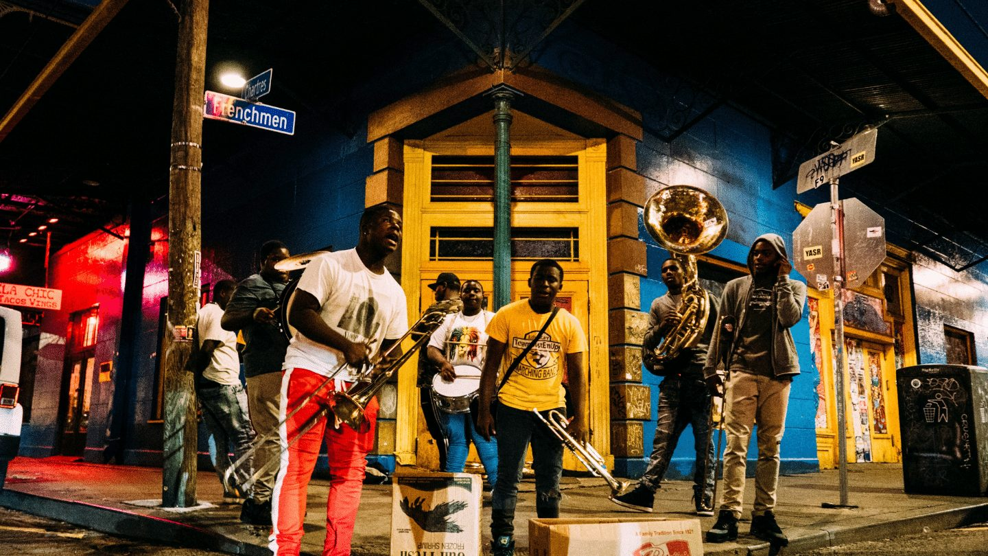 group of men playing brass instruments in New Orleans - restart travel deals