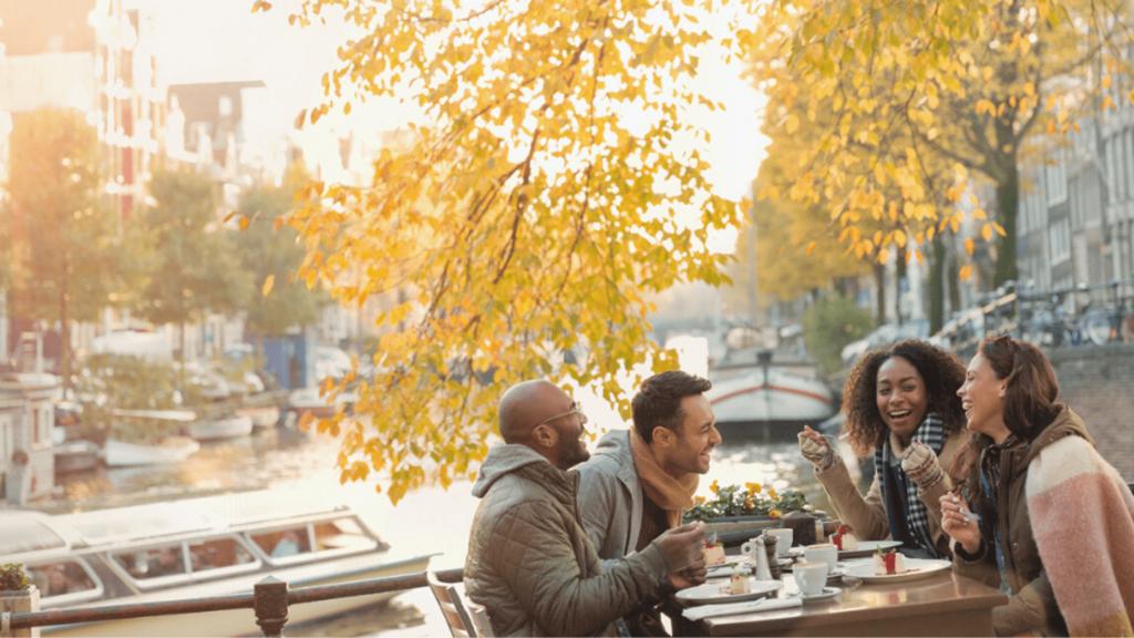 four friends enjoying alfresco dining