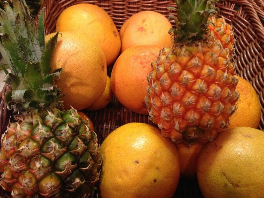 basket of oranges and pineapples food in Tanzania