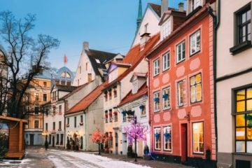 snowy street colourful buildings Christmas in Riga Latvia