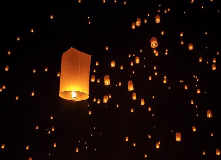 Globos or paper lanterns lighting up the night sky