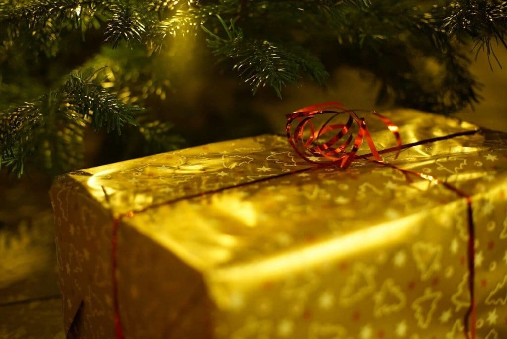 present in gold wrapping under the Christmas tree
