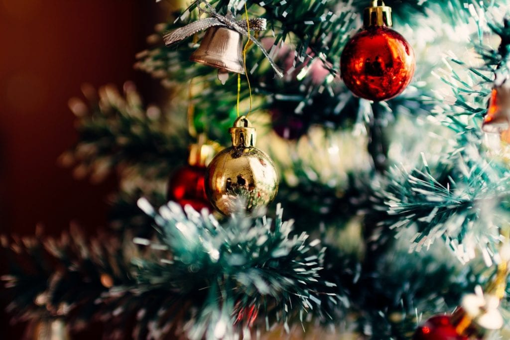 Decorated Christmas tree with red and gold ordainments for the holidays
