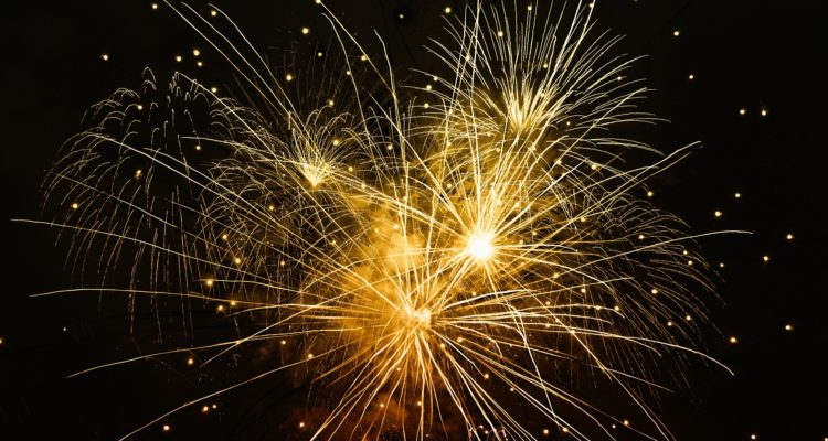 Gold firework display lighting up the night sky