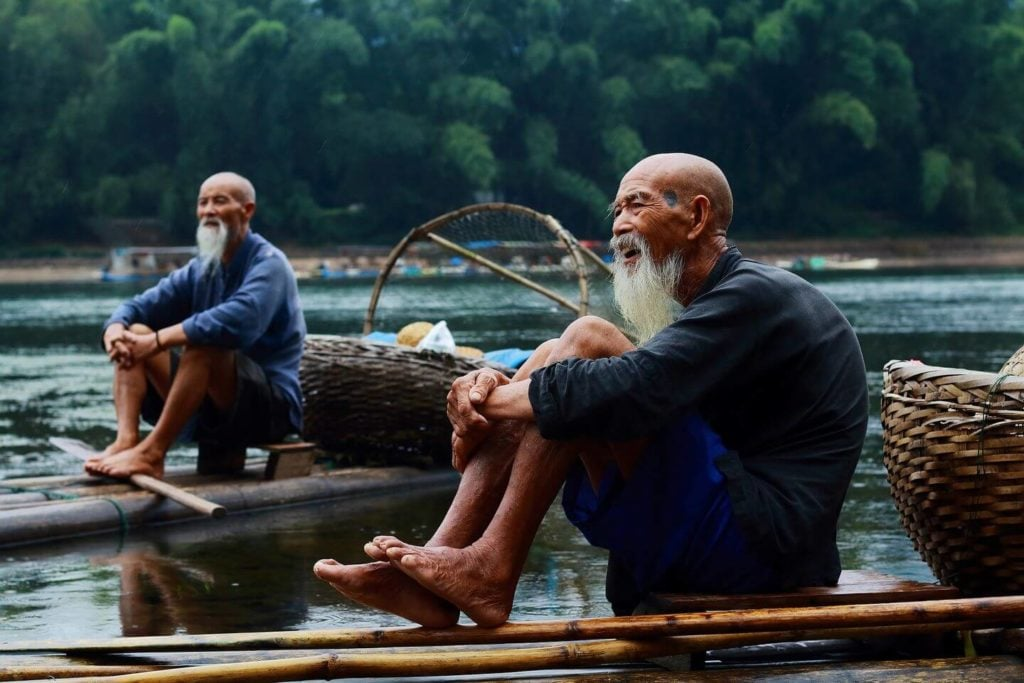 local fishermen with baskets China travel guide