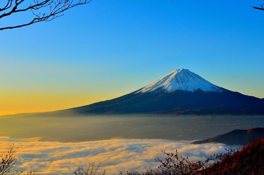 snow capped Mount Fuji at sunrise Japan