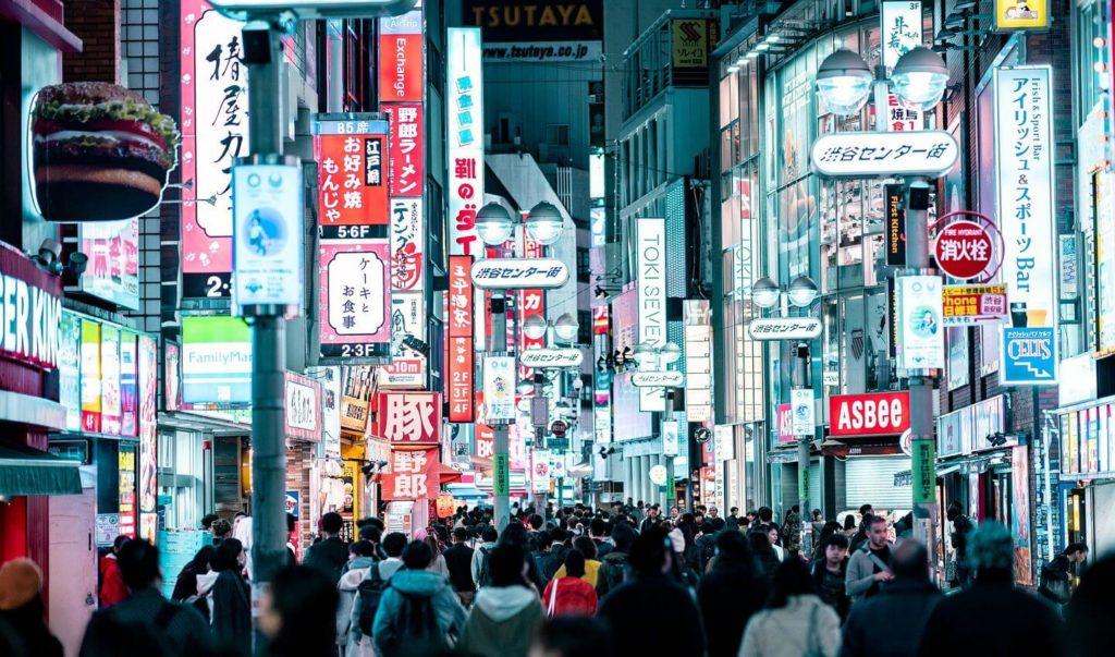 crowds and neon lights of Shibuya district Tokyo