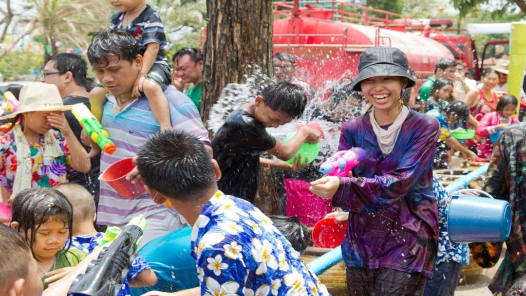 People with buckets of water celebrating Songkran