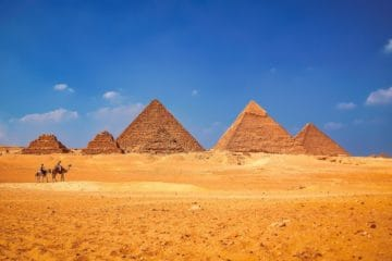 Pyramids of Giza camels desert