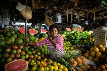 Kenyan woman in Nairobi fruit market Swahili phrases