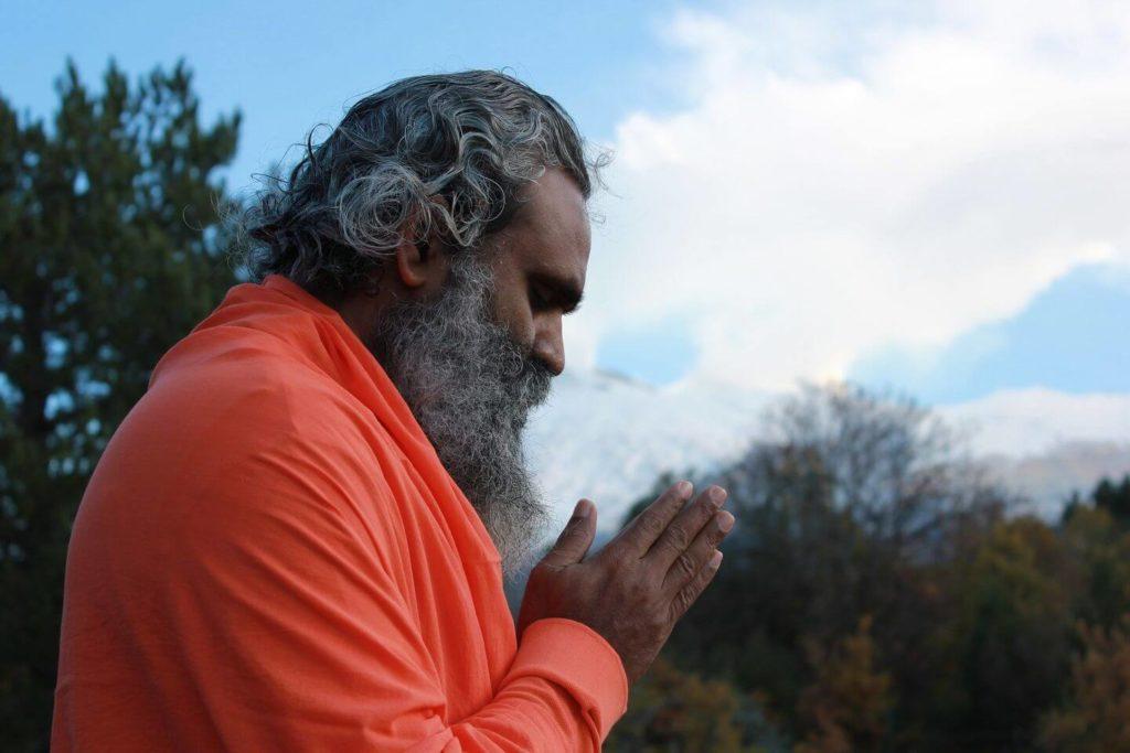 Indian man praying Indian culture