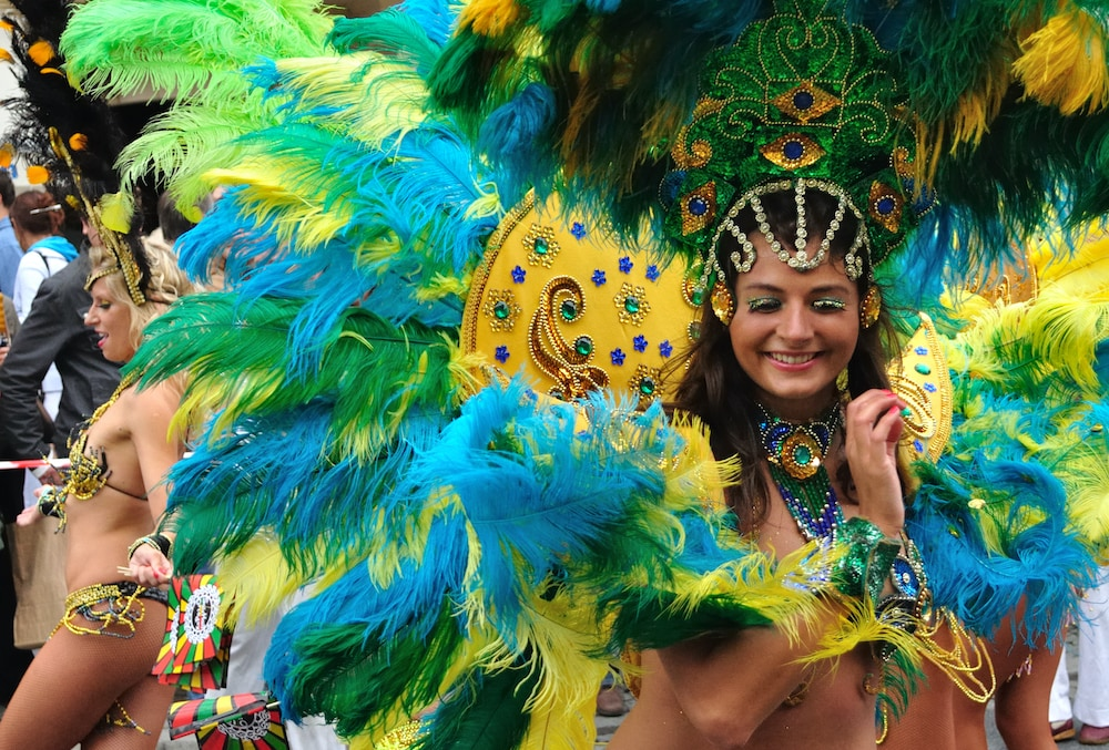 A samba school dancer in a colourful costume performing at Rio Carnival.
