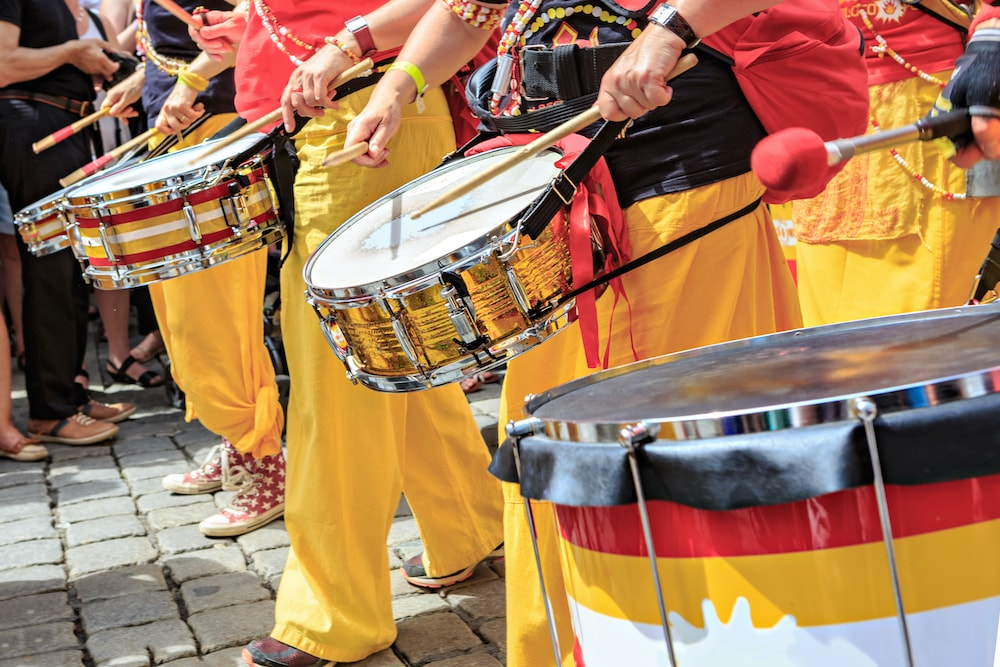 Samba school musicians with drums and colourful costumes performing at Rio Carnival.