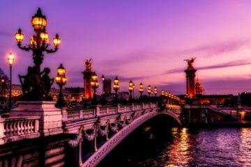purple sunset over Paris bridge and Seine River