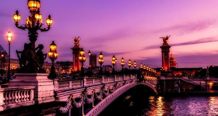purple sunset over Paris bridge and Seine River