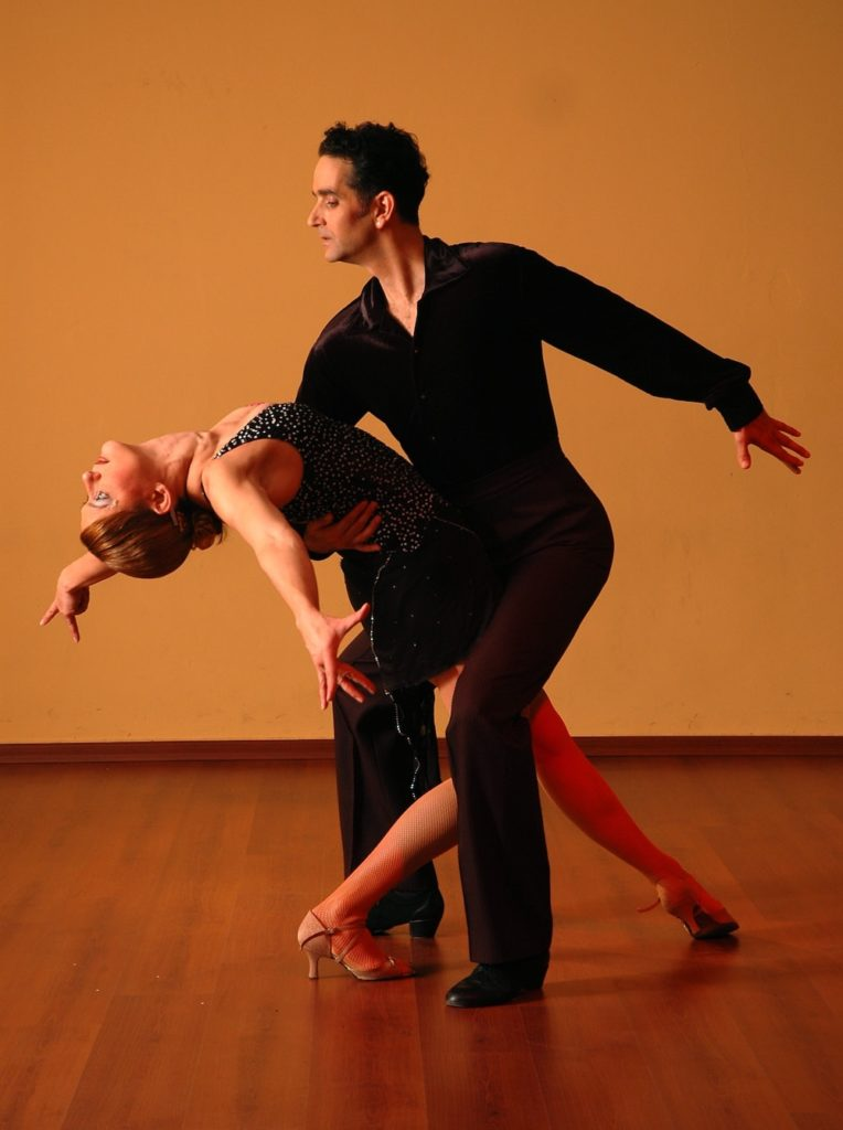 Professional dangers performing the salsa.